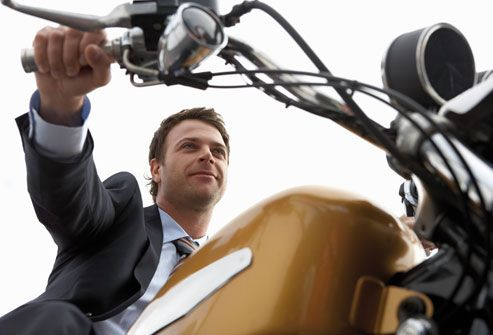 Man Taking Time For Self on Motorcycle