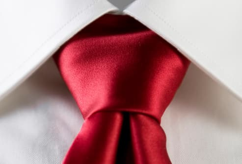 Red necktie with white shirt