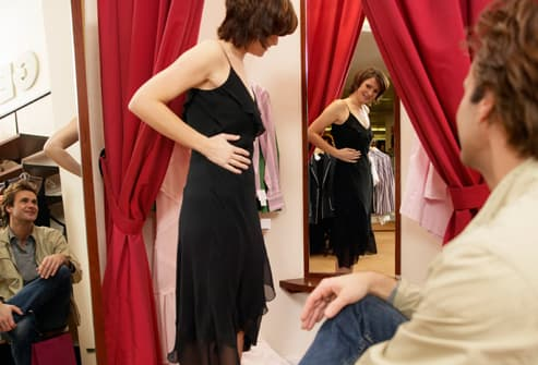 Woman trying on dress for her boyfriend