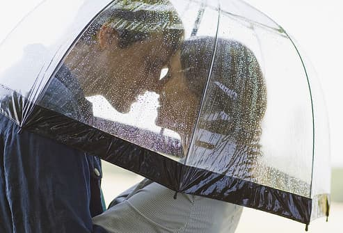 Couple embracing under umbrella