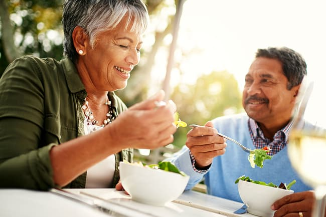 photo of mature couple eating
