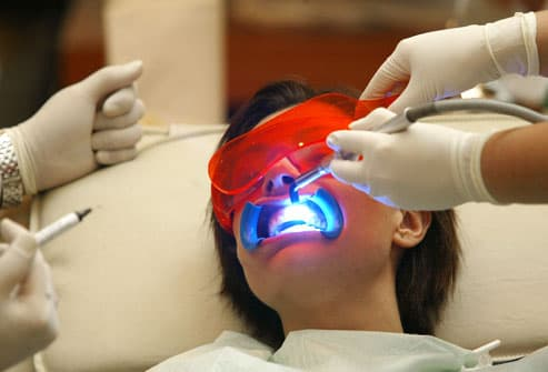 Woman Having Teeth Whitened