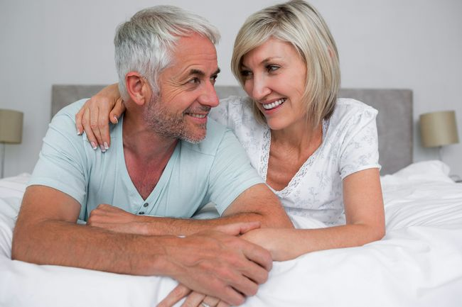 photo of mature couple on bed