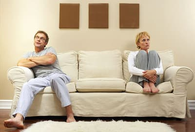 Arguing couple on sofa
