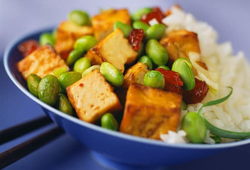 Tofu and edamame in bowl with rice