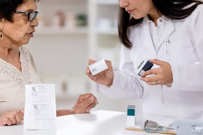 photo of pharmacist talking to patient