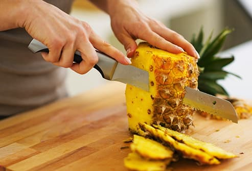 cutting pineapple