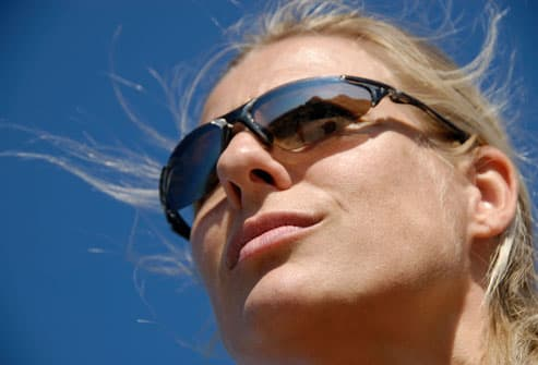 Woman with fair complexion in strong sun