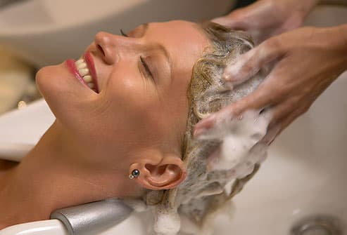 Scalp massage during spa shampoo