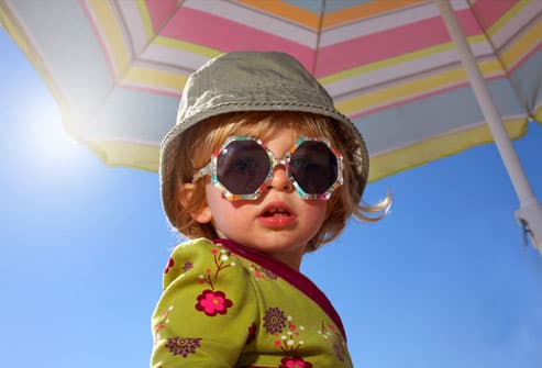 Toddler protected from the sun