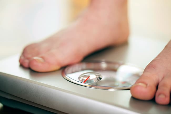 photo of feet on weight scale