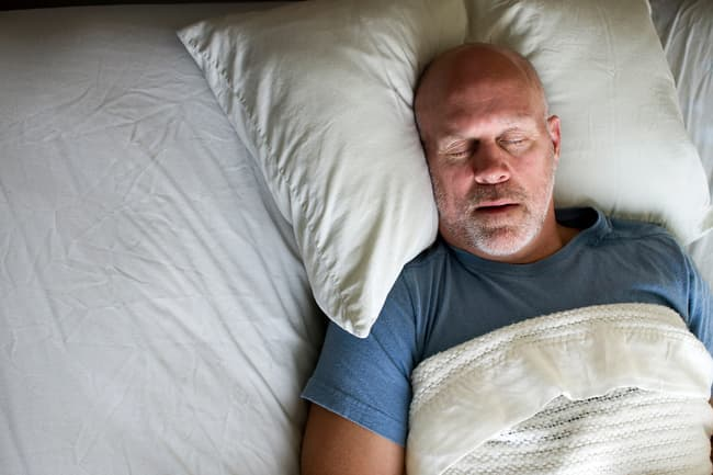 photo of man snoring