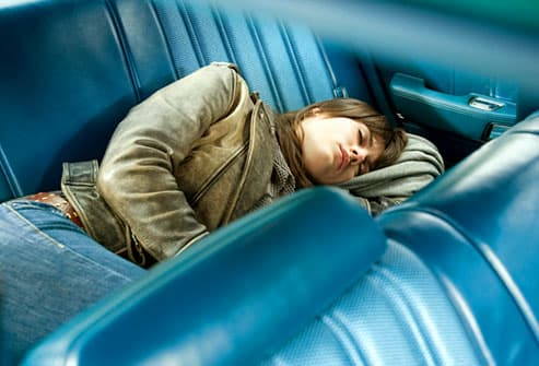 Woman napping in the back seat of her car