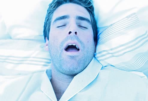 Man Suffering From Sleep Apnea