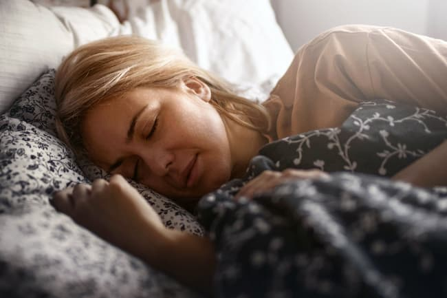 photo of woman sleeping in bed