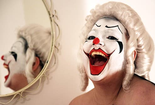 clown laughing by mirror
