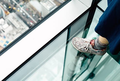 standing on glass floor in skyscraper