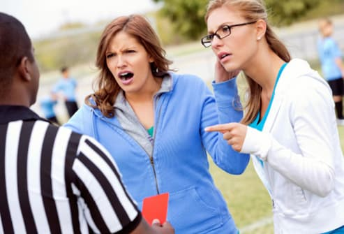 soccer moms arguing with referee