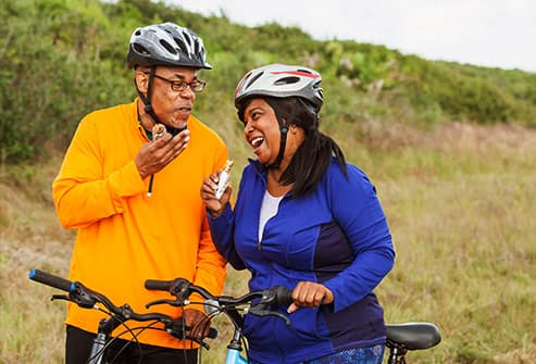 mature couple biking