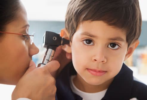 boy having ear exam