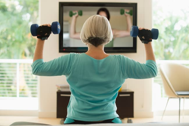 photo of woman exercising with hand weights