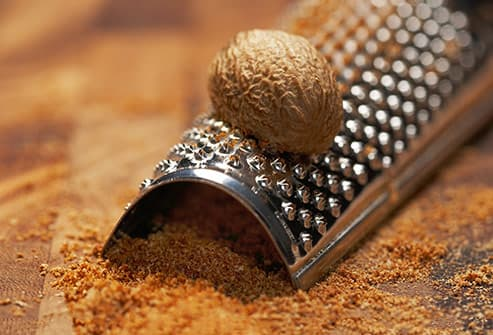 grated nutmeg and whole seed