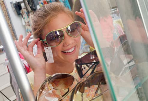 Girl About To Shoplift Sunglasses