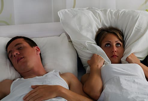 woman cant sleep man snors