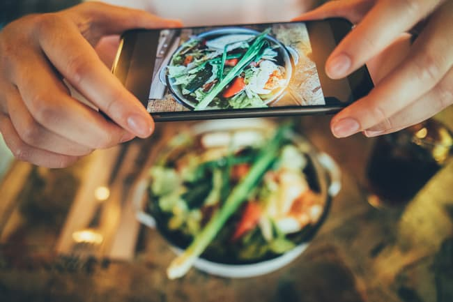photo of person photographing food