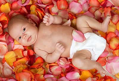baby on rose petals