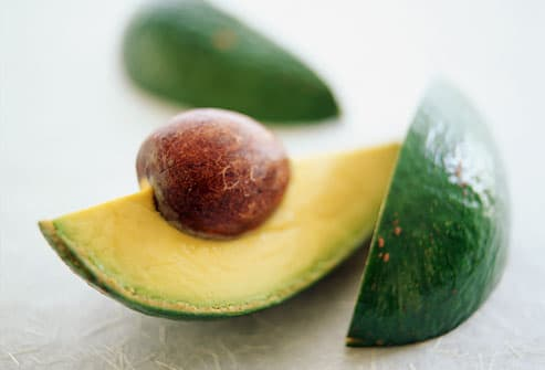 Close-up of an avocado sliced in wedges