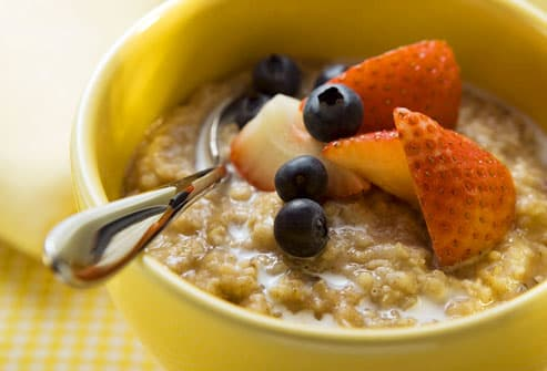 Bowl of oatmeal with milk and berries