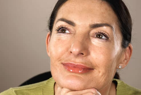 Mature woman with uneven skin tone