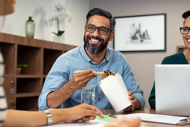photo of man eating lunch