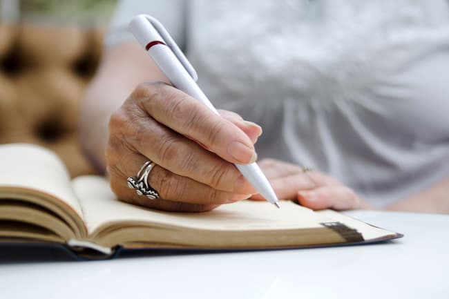 photo of writing in journal
