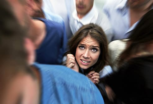 anxious woman in crowd