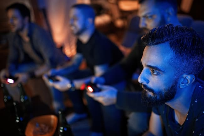 photo of guys playing video games