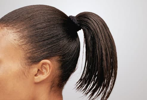 Woman With High and Tight Ponytail