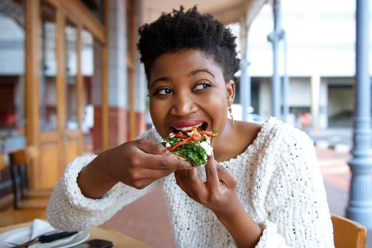 photo of woman eating