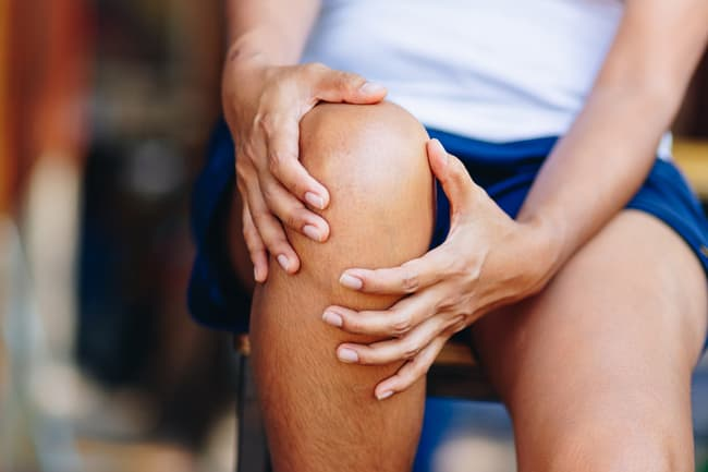 photo of woman with sore knee