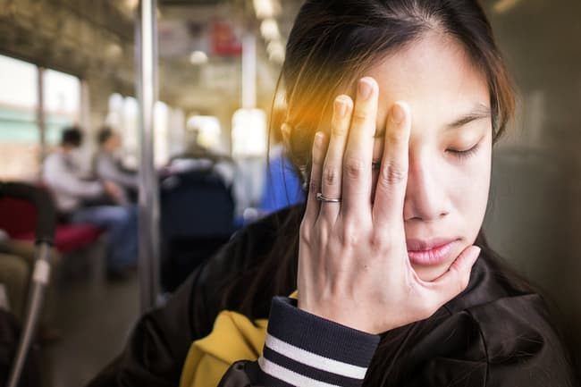 photo of tired woman on train