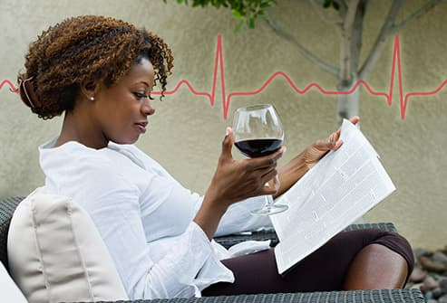 woman reading with wine plus ecg