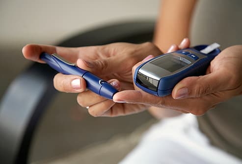 woman testing blood glucose level