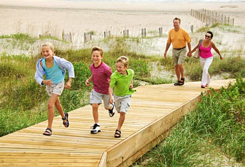Family using walkover to preserve beach dunes