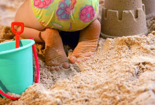 Toddler building a sand castle
