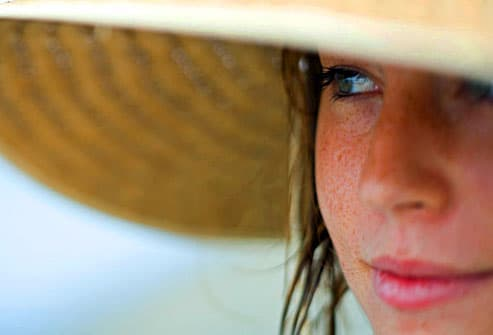 Young woman wearing wide brim sunhat