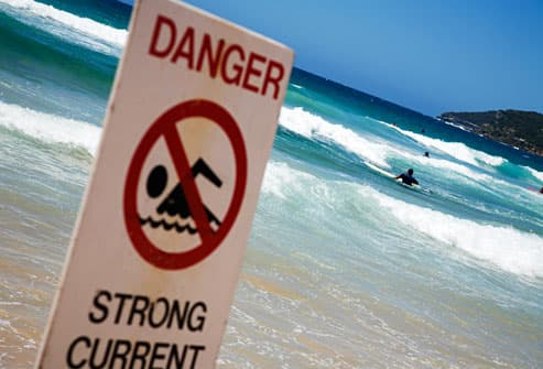Dangerous current sign on beach