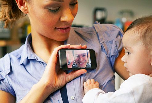 man facetiming with baby via cell