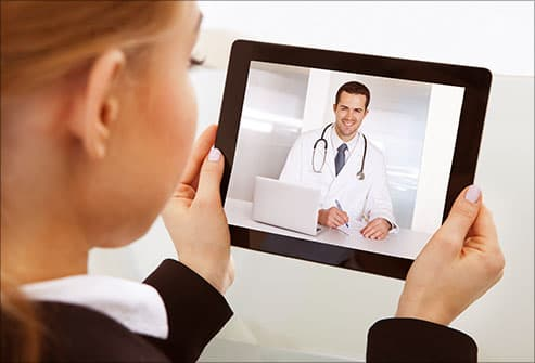 woman skyping with doctor