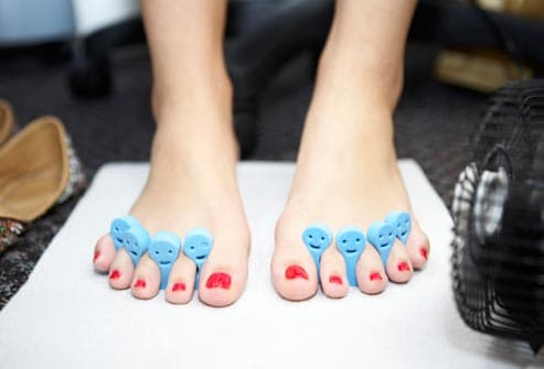 teen getting pedicure